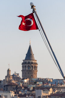 Turkey, Istanbul, Turkish flag in front of Galata Tower - KEBF000153
