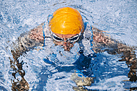 Spain, Mallorca, Sa Coma, triathlet  swimmer coming up out of the water - MFF001612
