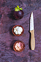 Whole and opened mangosteens and a kitchen knife - KNTF000022