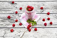 Raspberries, chia, milk, kiwi, hemp seed and mint in a glass - LVF003316