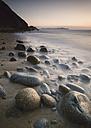Spain, Galicia, Valdovino, Rocky beach at sunset - RAEF000164