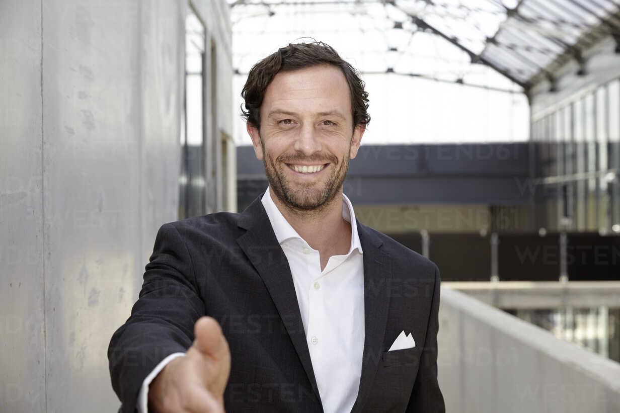 Portrait of smiling businessman in a modern building - FMKF001534 - Jo Kirchherr/Westend61