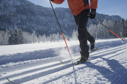 Germany, Bavaria, Inzell, skier in snow-covered landscape - FFF001446