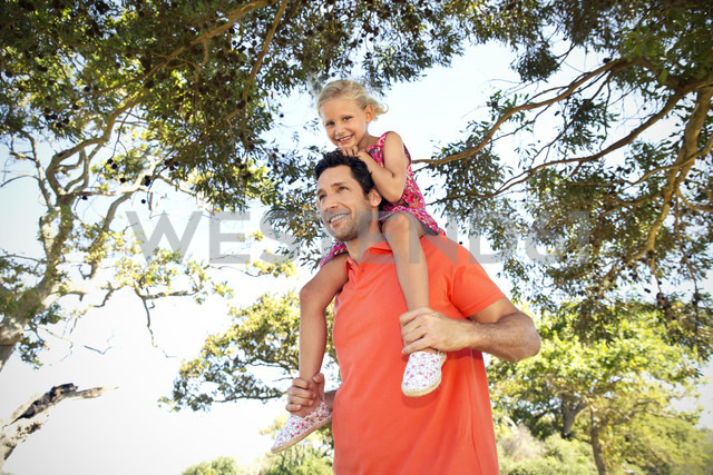 Happy father carrying daughter on shoulders - TOYF000232