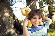 Portrait of smiling boy with cuddly toy outdoors - TOYF000254