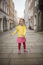 Germany, Bavaria, smiling little girl standing in an alley - OPF000055