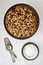 Rhubarb crumble cake in a baking dish and bowl of whipped cream - EVGF001703