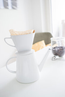 White coffee filter on coffee pot on a table - FLF001011