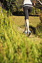 Woman jogging in rural landscape - TOYF000330