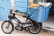 Morocco, Essaouria, parked moped with basket of bread - HSK000028