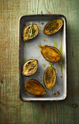 Casserole of fried baby aubergine slices with basil pesto and rosemary - KSWF001497