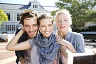 Happy friends outdoors taking a selfie - TOYF000537