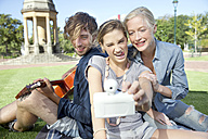 Happy friends in park taking a selfie - TOYF000542