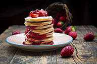 Stack of pancakes with strawberry sauce and strawberries - LVF003371