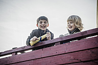Two little boys having fun on a playground - MJF001521