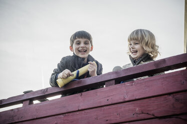 Two little boys having fun on a playground - MJF001521