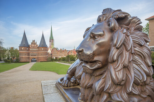 Germany, Luebeck, bronze Lion in front of Holsten Gate - NKF000246