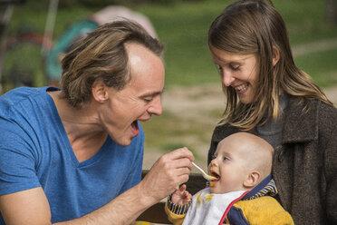 Man feeding his little son - FBF000393