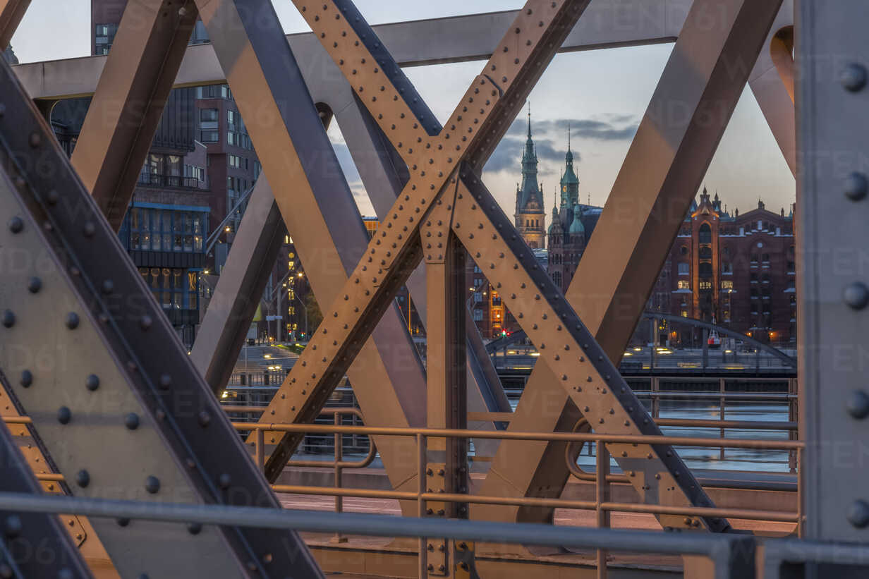 Germany, Hamburg, tower of the townhall and parts of historic warehouse district  seen through a frame bridge - NKF000253 - Stefan Kunert/Westend61