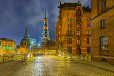 Germany, Hamburg, St. Catherine's Church in the old Warehouse District at night - NKF000258