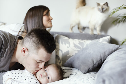 Young family with cat in living room - STKF001267