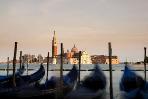 Italy, Venice, gondolas in front of San Giorgio Maggiore at dusk - MKFF000214
