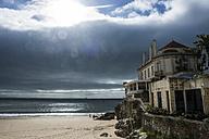 Portugal, Cascais, dramatic light over the beach and a old villa - RUN000076