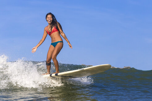 Indonesia, Bali, woman surfing - KNTF000035