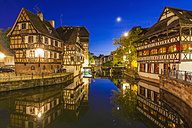 France, Alsace, Strasbourg, La Petite France, half-timbered houses, L'Ill river at night - WDF003104