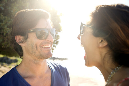 South Africa, woman laughing at smiling boyfriend - TOYF000692