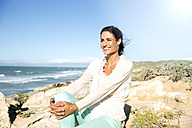 South Africa, portrait of smiling woman looking at distance - TOYF000763