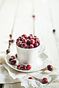 Fresh cranberries in a coffee cup - SBDF001883