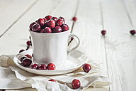 Fresh cranberries in a coffee cup - SBDF001886