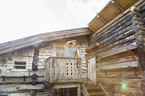 Austria, Salzburg State, Maria Alm, woman standing at alpine hut - NN000353