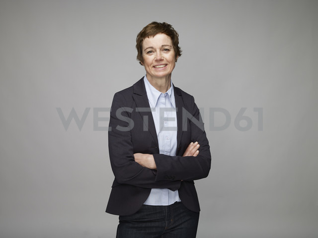 Portrait of smiling mature woman with crossed arms - RH000863
