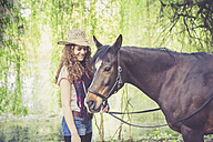 Smiling young woman with Arabian horse - SARF001801