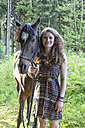 Smiling young woman with Arabian horse - SARF001805