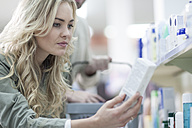Woman shopping at drugstore - ZEF005825