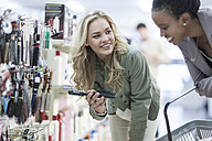 Friends shopping at drugstore - ZEF005827