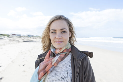 South Africa, Cape Town, portrait of smiling woman standing on the beach - ZEF005265
