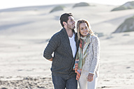 South Africa, Cape Town, young couple walking on the beach - ZEF005235