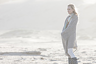 South Africa, Cape Town, young woman standing on the beach - ZEF005242