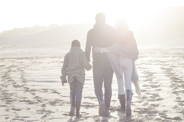 South Africa, Cape Town, back view of family walking on the beach at backlight - ZEF005251