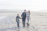 South Africa, Cape Town, young couple with two children walking on the beach - ZEF005258