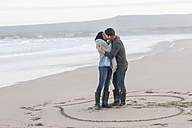 South Africa, Cape Town, young couple kissing on the beach - ZEF005278