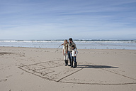 South Africa, Witsand, family playing tic tac toe on the beach - ZEF005321