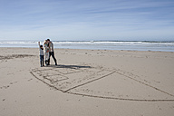 South Africa, Witsand, family playing tic tac toe on the beach - ZEF005322