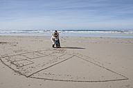 South Africa, Witsand, family playing tic tac toe on the beach - ZEF005323