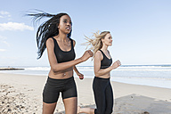 South Africa, Cape Town, two women jogging on the beach - ZEF005196