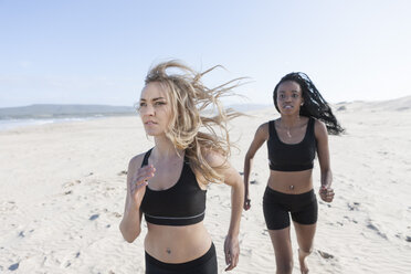 South Africa, Cape Town, two women jogging on the beach - ZEF005199